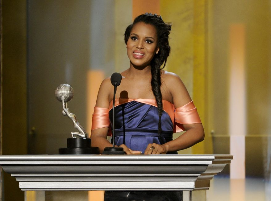 """Kerry Washington accepts the award for outstanding actress in a drama series for """"Scandal"""" at the 45th NAACP Image Awards at the Pasadena Civic Auditorium on Saturday, Feb. 22, 2014, in Pasadena, Calif. (Photo by Chris Pizzello/Invision/AP)"""