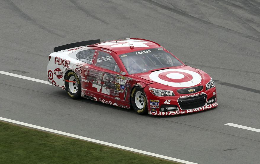 Kyle Larson (42) drives his damaged car down pit road after hitting the wall during the NASCAR Daytona 500 Sprint Cup series auto race at Daytona International Speedway in Daytona Beach, Fla., Sunday, Feb. 23, 2014. (AP Photo/David Graham)