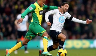 Norwich City's Martin Olsson, left, and Tottenham Hotspur's Aaron Lennon compete for the ball during their English Premier League soccer match at Carrow Road, Norwich, England, Sunday, Feb. 23, 2014. (AP Photo/Stephen Pond, PA Wire)    UNITED KINGDOM OUT   -  NO SALES   -   NO ARCHIVES