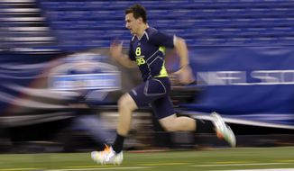 Texas A&M quarterback Johnny Manziel runs the 40-yard dash at the NFL football scouting combine in Indianapolis, Sunday, Feb. 23, 2014. (AP Photo/Michael Conroy)