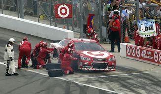 Crew members work to repair Kyle Larson's car during the NASCAR Daytona 500 Sprint Cup series auto race at Daytona International Speedway, Sunday, Feb. 23, 2014, in Daytona Beach, Fla.. (AP Photo/David Graham)