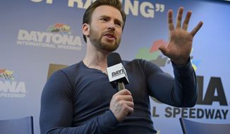 Actor Chris Evans answers a question during a news conference before the NASCAR Daytona 500 Sprint Cup series auto race at Daytona International Speedway in Daytona Beach, Fla., Sunday, Feb. 23, 2014. (AP Photo/Phelan M. Ebenhack)