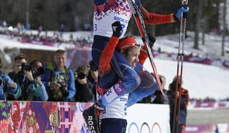 Russia's Alexander Legkov, the gold medal winner, is carried on the shoulders of bronze medalist Russia's Ilia Chernousov after the men's 50K cross-country race at the 2014 Winter Olympics, Sunday, Feb. 23, 2014, in Krasnaya Polyana, Russia. (AP Photo/Gregorio Borgia)