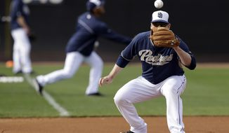 San Diego Padres third baseman Chase Headley waits for a throw in fielding drills during spring training baseball practice, Friday, Feb. 21, 2014, in Peoria, Ariz. (AP Photo/Tony Gutierrez)