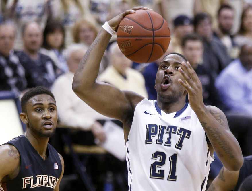 Pittsburgh's Lamar Patterson (21) shoots in front of Florida State's Ian Miller, left, during the first half of an NCAA college basketball game, Sunday, Feb. 23, 2014, in Pittsburgh. (AP Photo/Keith Srakocic)
