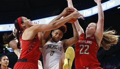 Georgia Tech's Aaliyah Whiteside (2) battles Maryland center Brionna Jones , left, and forward Tierney Pfirman (22) for a rebound in the first half of an NCAA women's college basketball game, Sunday, Feb. 23, 2014, in Atlanta. (AP Photo/John Bazemore)