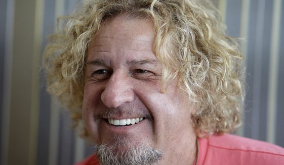 In this Saturday, Feb. 22, 2014 photo, In this Saturday, Feb. 22, 2014 photo, musician Sammy Hagar smiles during an interview in Miami. (AP Photo/Lynne Sladky)