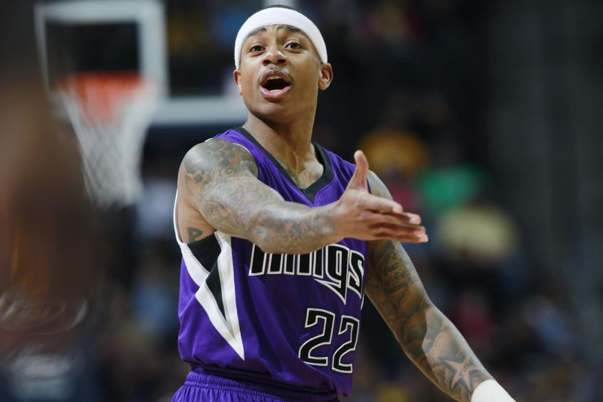 Sacramento Kings guard Isaiah Thomas directs his teammates as the Kings face the Denver Nuggets in the first quarter of an NBA basketball game in Denver, Sunday, Feb. 23, 2014. (AP Photo/David Zalubowski)