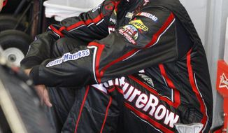 Martin Truex Jr waist by his car before practice for Sunday's NASCAR Daytona 500 Sprint Cup series auto race at Daytona International Speedway in Daytona Beach, Fla., Saturday, Feb. 22, 2014. (AP Photo/Terry Renna)