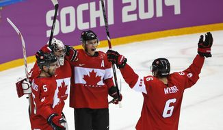 Dan Hamhuis of Canada (5), goalkeeper Carey Price of Canada (31), Jonathan Toews of Canada (16) and Shea Weber of Canada (6) celebrate their 3-0 win over Sweden in the men's gold medal ice hockey game at the 2014 Winter Olympics, Sunday, Feb. 23, 2014, in Sochi, Russia. (AP Photo/Petr David Josek)