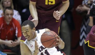 Utah's Brandon Taylor (11) goes after a loose ball as Arizona State's Egor Koulechov (15) looks on in the first half of an NCAA college basketball game, Sunday, Feb. 23, 2014, in Salt Lake City. (AP Photo/Rick Bowmer)