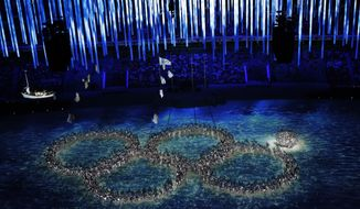 Performers recreate the fifth Olympic ring that didn't open in the opening ceremony during the closing ceremony of the 2014 Winter Olympics, Sunday, Feb. 23, 2014, in Sochi, Russia. (AP Photo/David J. Phillip )