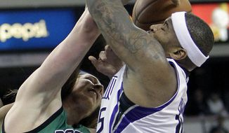 Boston Celtics forward Kelly Olynyk, left, battles Sacramento Kings center DeMarcus Cousins for the ball during the first quarter of an NBA basketball game in Sacramento, Calif., Saturday, Feb. 22, 2014. (AP Photo/Rich Pedroncelli)