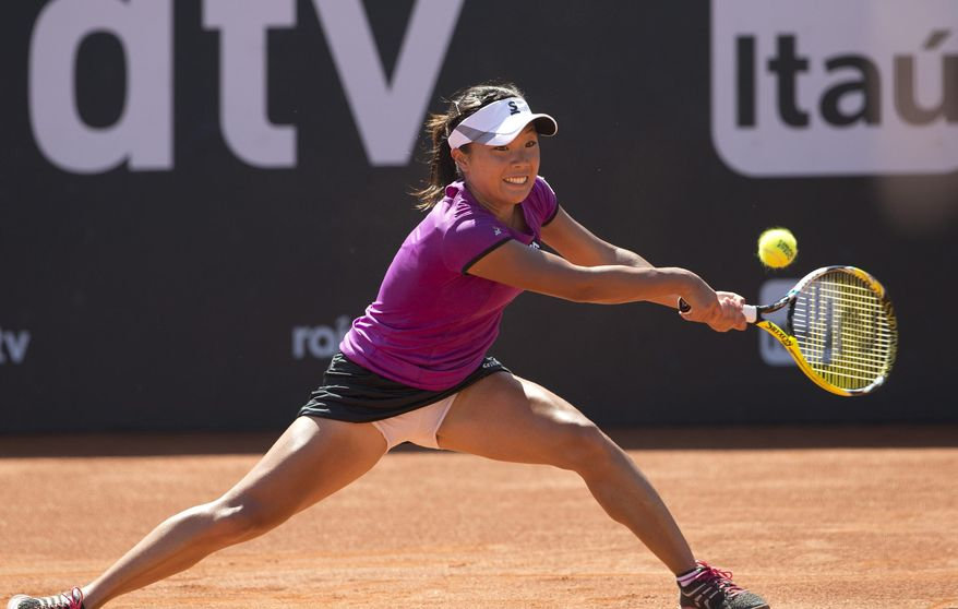 Kurumi Nara of Japan, returns the ball to Klara Zakopalova of the Czech Republic   during the finals at the Rio Open tennis tournament in Rio de Janeiro, Brazil, Sunday, Feb.23, 2014. (AP Photo/Silvia Izquierdo)