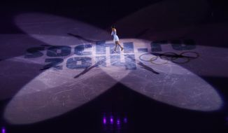 Yuna Kim of South Korea performs during the figure skating exhibition gala at the Iceberg Skating Palace during the 2014 Winter Olympics, Saturday, Feb. 22, 2014, in Sochi, Russia. (AP Photo/Vadim Ghirda)