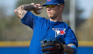 Toronto Blue Jays Brett Lawrie throws at Spring Training in Dunedin, Fla., on Sunday, Feb. 23, 2014. (AP Photo/The Canadian Press, Frank Gunn)