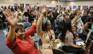 """IMAGE DISTRIBUTED FOR AIDS HEALTHCARE FOUNDATION - The audience embraces the message at AIDS Healthcare Foundation's community forum in a nationwide series on """"AIDS is a Civil Rights Issue"""" at Holman United Methodist Church, Sunday, Feb. 23, 2014, in Los Angeles. The events highlight the disproportionate impact of HIV/AIDS on African-American and Latino communities in the US, and includes events in Mississippi, Texas, California and Louisiana. (Bret Hartman/AP Images for AIDS Healthcare Foundation)"""