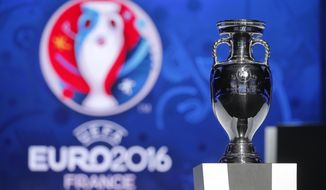 The UEFA EURO 2016 trophy is displayed during the qualifying draw ceremony at the Acropolis Convention Centre in Nice, southeastern France, Sunday, Feb 23, 2014.  (AP Photo/Lionel Cironneau)
