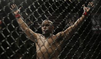 Daniel Cormier reacts after the referee stopped his UFC 170 mixed martial arts light heavyweight fight against Patrick Cummins on Saturday, Feb. 22, 2014, in Las Vegas. (AP Photo/Isaac Brekken)