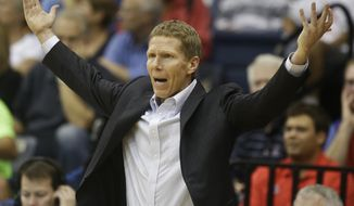 Gonzaga coach Mark Few wants to know what his team is doing during the second half of their 69-66 defeat to San Diego in a NCAA college basketball game Saturday, Feb. 22, 2014, in San Diego. (AP Photo/Lenny Ignelzi)