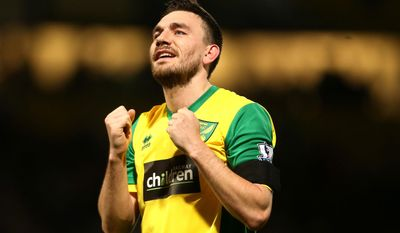 Norwich City's goal scorer Robert Snodgrass celebrates at the end of their Emglish Premier League soccer match against Tottenham Hotspur at Carrow Road, Norwich, England, Sunday, Feb. 23, 2014. (AP Photo/Stephen Pond, PA Wire)    UNITED KINGDOM OUT    -   NO SALES   -   NO ARCHIVES