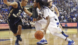 Saint Louis' Jordair Jett, right, heads to the basket as George Washington's Joe McDonald defends during the second half of an NCAA college basketball game Saturday, Feb. 22, 2014, in St. Louis. Saint Louis won 66-59. (AP Photo/Whitney Curtis)