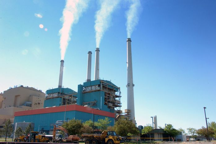 **FILE** Smoke rises from the Colstrip Steam Electric Station, a coal burning power plant in in Colstrip, Mont., on July 1, 2013. Colstrip is kind of plant called on by President Barack Obama's climate change plan to reduce carbon dioxide emissions. On Feb. 24, 2014, the U.S. Supreme Court will hear arguments on the unanimous federal appeals court ruling that upheld the Environmental Protection Agency's unprecedented regulations, aimed at reducing the greenhouse gases blamed for global warming. The case comes to the court amid Obama's increasing use of his executive authority to act on environmental and other matters when Congress doesn't, or won't. (Associated Press)