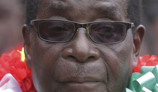 Zimbabwe's President Robert Mugabe attends celebrations to mark his 90th birthday in Marondera, east of  Harare, Sunday, Feb. 23, 2014. In July, Mugabe who has ruled the nation for 33 years since 1980, won disputed elections for another five-year term that will take him to age 94.  (AP Photo/Tsvangirayi Mukwazhi)