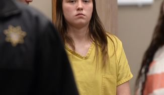 Meagan Grunwald, 17, who has been charged as an adult in the shootings of two Utah deputies, makes her first appearance in Judge Darold McDade's court in Provo, Utah, on Monday, Feb. 24, 2014. The counts against her include obstructing justice, aggravated robbery and use of a controlled substance. (AP Photo/The Salt Lake Tribune, Al Hartmann, Pool)