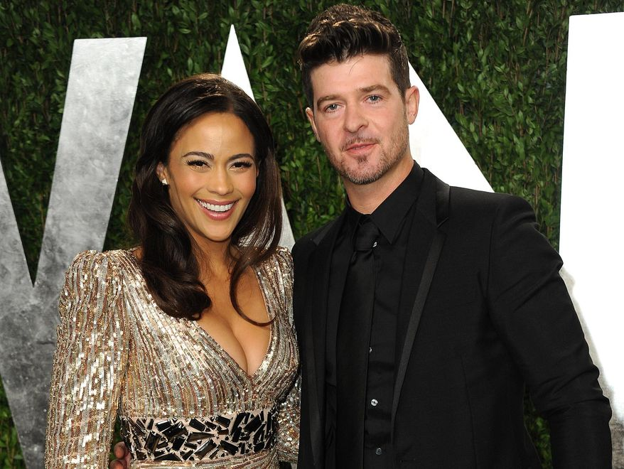 ** FILE ** In this Feb. 24, 2013, file photo, Paula Patton and Robin Thicke arrive at the 2013 Vanity Fair Oscars Viewing and After Party at the Sunset Plaza Hotel in West Hollywood, Calif. Thicke and Patton are calling it quits. A representative for the actress confirmed on Monday, Feb. 24, 2014, the two are ending their nine-year-old marriage. (Photo by Jordan Strauss/Invision/AP, File)