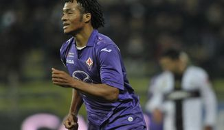 Fiorentina's Guillermo Cuadrado of Colombia celebrates after scoring a goal during their Serie A soccer match against Parma, at Parma's Tardini stadium, Italy, Monday, Feb. 24, 2014. (AP Photo/Marco Vasini)