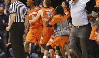 Syracuse coach Jim Boeheim, right, and players react to an official's call late in the second half of an NCAA college basketball game against Duke in Durham, N.C., Saturday, Feb. 22, 2014. Duke won 66-60. (AP Photo/Gerry Broome)