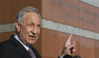 Attorney Mark Geragos comments on his client, California state Sen. Ron Calderon (D-Montebello), outside the Edward R. Royal Federal Court building, Monday, Feb. 24, 2014, in Los Angeles. Calderon pleaded not guilty Monday to federal charges that he accepted $100,000 in bribes in return for pushing legislation, charges that could send him to federal prison for years. (AP Photo/Damian Dovarganes)