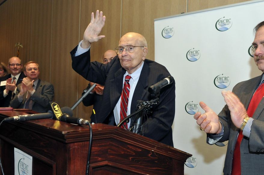 U.S. Rep. John Dingell, center, is welcomed as he arrives at the Southern Wayne County Regional Chamber (SWCRC) Legislative forum held at the Crystal Gardens in Southgate, Mich. on Monday, Feb. 24, 2014. Dingell, the longest-serving member of Congress in American history and a champion of Detroit's auto industry, has announced his retirement. (AP Photo/Detroit News, Max Ortiz)  DETROIT FREE PRESS OUT; HUFFINGTON POST OUT