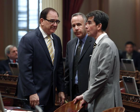 Senate Minority Leader Bob Huff, R-Diamond Bar, left, huddles with Senate President Pro Tem Darrell Steinberg, D-Sacramento, center and Sen. Mark Leno, D-San Francisco, at the Capitol in Sacramento, Calif., Monday, Feb. 24, 2014. After a closed door meeting, Senate Democrats said they will give state Sen. Ron Calderon, D-Montebello, one week to resign or take an indefinite leave of absence. If he does not, the Senate will move to suspend him. Calderon pleaded not guilty Monday to federal corruption charges involving bribes, kickbacks and fraud. (AP Photo/Rich Pedroncelli)