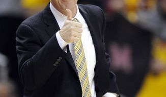 Maryland head coach Mark Turgeon gestures during the first half of an NCAA college basketball game against Syracuse, Monday, Feb. 24, 2014, in College Park, Md. Syracuse won 57-55. (AP Photo/Nick Wass)