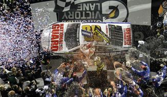 Dale Earnhardt Jr. celebrates in Victory Lane after winning the NASCAR Daytona 500 Sprint Cup series auto race at Daytona International Speedway in Daytona Beach, Fla., Sunday, Feb. 23, 2014. (AP Photo/John Raoux)