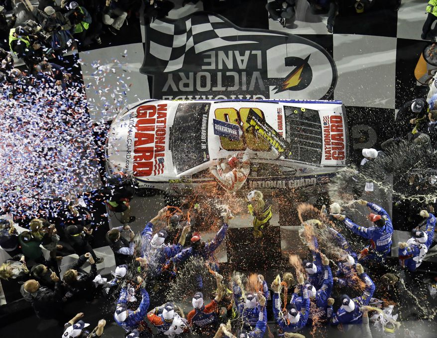 Dale Earnhardt Jr. celebrates in Victory Lane after winning the NASCAR Daytona 500 Sprint Cup series auto race at Daytona International Speedway in Daytona Beach, Fla., Sunday, Feb. 23, 2014. (AP Photo/John Raoux)