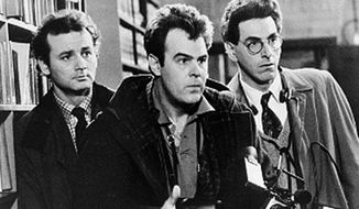 "FILE - In an undated file photo, Bill Murray, Dan Aykroyd, center, and Harold Ramis, right, appear in a scene from the 1984 movie ""Ghostbusters"". Harold Ramis died early Monday, Feb. 24, 2014, in Chicago from complications of autoimmune inflammatory disease, according Fred Toczek , an attorney for Ramis. He was 69. (AP Photo, File)"