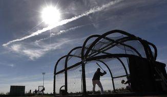 Chicago White Sox's Paul Konerko takes batting practice during spring training baseball practice in Glendale, Ariz., Saturday, Feb. 22, 2014. (AP Photo/Paul Sancya)