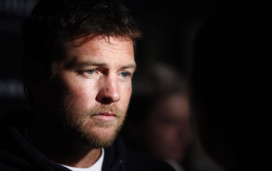 """** FILE ** In this Jan. 19, 2012, file photo, actor Sam Worthington attends the Cinema Society premiere of """"Man on a Ledge"""" in New York. Police say Worthington has been arrested Sunday, Feb. 23, 2014, in New York City for punching a photographer after the man kicked Worthington's girlfriend in the shin. The Australian actor was released on a desk appearance ticket and is due back in court on Feb. 26. (AP Photo/Peter Kramer, File)"""