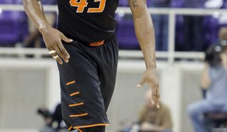 Oklahoma State guard Marcus Smart looks for space against the TCU defense in the first half of an NCAA college basketball game, Monday, Feb. 24, 2014, in Fort Worth, Texas. (AP Photo/Brandon Wade)