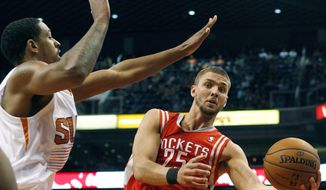 Houston Rockets forward Chandler Parsons (25) drives on Phoenix Suns forward Channing Frye (8) in the second quarter of an NBA basketball game, Sunday, Feb. 23, 2014, in Phoenix. (AP Photo/Rick Scuteri)