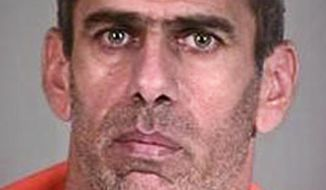 FILE - This undated photo provided by the Pinal County Sheriff's Office, shows Abdullatif Ali Aldosary, an Iraqi man charged with detonating a homemade explosive device outside an Arizona Social Security Administration office building, in Phoenix. Aldosary has been sentenced to five years in federal prison for felony weapons possession. (AP Photo/Pinal County Sheriffs Office, File)