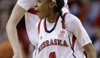 Nebraska's Tear'a Laudermill (1) and Emily Cady celebrate after Laudermill hit a 3-pointer in the first half of an NCAA college basketball game against Penn State in Lincoln, Neb., Monday, Feb. 24, 2014. (AP Photo/Nati Harnik)