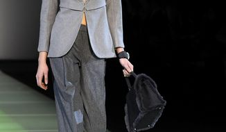 A model wears a creation for Giorgio Armani women's Fall-Winter 2014-15 collection, part of the Milan Fashion Week, unveiled in Milan, Italy, Monday, Feb. 24, 2014. (AP Photo/Giuseppe Aresu)