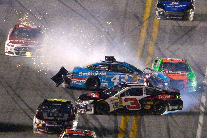 Aric Almirola (43), Austin Dillon (3) and Danica Patrick (10) collide on the front stretch during the NASCAR Daytona 500 auto race at Daytona International Speedway in Daytona Beach, Fla., Sunday, Feb. 23, 2014. (AP Photo/Phelan M. Ebenhack)