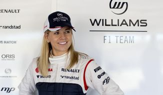 FILE - In this Jan. 30, 2012, photo taken from files and released by the Williams F1 Team on Wednesday, May 8, 2013, Susie Wolff poses for a photo at the Monte Blanco Circuit in Spain. Susie Wolff will become the first woman in 22 years to compete in a Formula One event during the upcoming season as she chases a chance to race for Williams. The 31-year-old Scot will take part in the first practice session ahead of both the British and German Grands Prix as part of her expanded development driver role with Williams. Wolff will take to the track at Silverstone ahead of the British GP in July, having made her full F1 test debut at the circuit last July. (AP Photo/Williams F1 Team, Malcolm Griffiths, File)