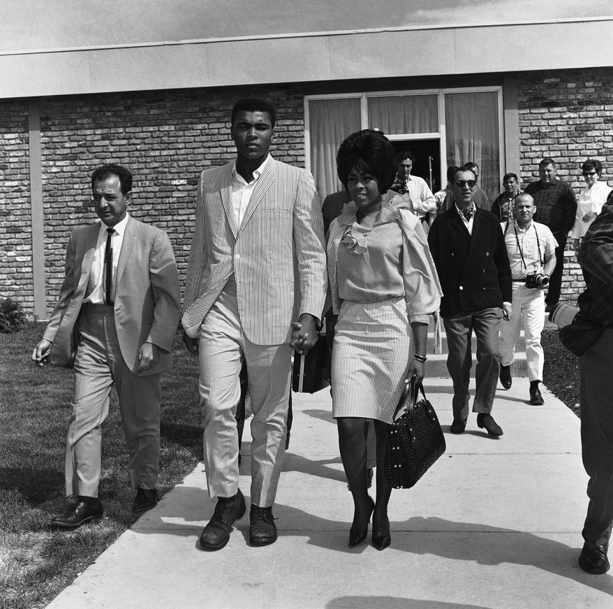 Heavyweight champion Muhammad Ali (Cassius Clay) formally requested on June 23, 1965 an annulment of his 10-month-old marriage to former model, Sonji Ray. Clay initiated the action because, he claims, his wife had not been a good ?Muslim.? They are shown leaving an Auburn, Md., inn on May 23, two days before Clay?s victorious title bout with Sonny Liston in Lewiston, Me. (AP Photo)