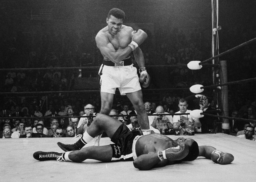 Heavyweight champion Muhammad Ali stands over fallen challenger Sonny Liston, shouting and gesturing shortly after dropping Liston with a short hard right to the jaw on May 25, 1965, in Lewiston, Maine.  The bout lasted only one minute into the first round.  Ali is the only man ever to win the world heavyweight boxing championship three times.  He also won a gold medal in the light-heavyweight division at the 1960 Summer Olympic Games in Rome as a member of the U.S. Olympic boxing team.  In 1964 he dropped the name Cassius Clay and adopted the Muslim name Muhammad Ali.  (AP Photo/John Rooney)
